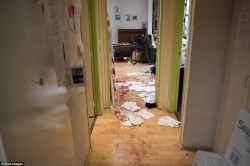 Shocking: The chilling image from the Charlie Hebdo office shows blood-stained wooden floors, papers strewn across the corridor. Photo courtesy: Ents Images/London Daily Mail