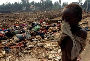 A Rwandan boy covers his face from the horrific stench of dead bodies, victims of the Rwandan Genocide. Credit: Reuters.