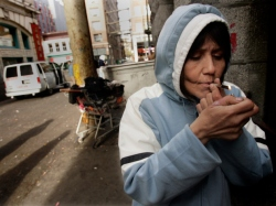 A woman smokes crack openly on a Downtown Eastside street in Vancouver.  Credit:  Brent Foster/National Post