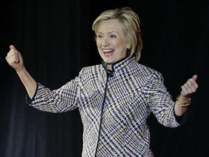 Hilary Clinton responds to the audiences ovations at the 2015 Women in the World Summit in New York.