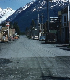 Color photo (1957): the picturesque, sleepy little seaside town of Valdez, Alaska - peaceful, family-centred, optimistic about the future...a