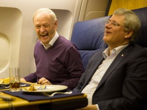 Former Prime Ministers Jean Chretien (Liberal) and Stephen Harper (Conservative), political foes, enjoy a laugh together as they flew 18 hours to Nelson Mandela's funeral last year.