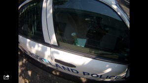 The can of Comet sits inside a police cruiser in Beaverton - evidence of an assault that was never prosecuted