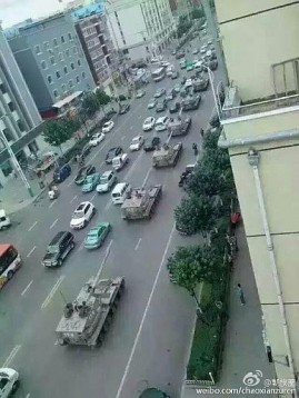 Chinese tanks roll through the streets of Yanji in Jilin province, toward the nearby China-Korea border on August 22