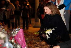 Rona Ambrose visits a memorial in Paris to the terrorist victims from the Friday the 13th attacks.