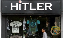 An Indian resident walks past a store named 'Hitler' in Ahmedabad, India, 01 September 2012. ( EPA/STR)