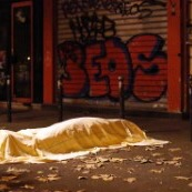 A body, draped with a white cloth, lies outside the Bataclan restaurant, one of several sites that ISIS fighters attacked on Friday the 13th. (Credit: CNN)