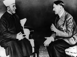 Amin Al Husseini, the Grand Mufti of Jerusalem, meets with Nazi leader Adolf Hitler in Jerusalem, November 1942, just weeks before the Final Solution was implemented.
