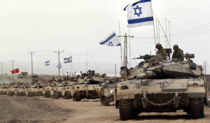 Israeli Merkava tanks near Israel-Gaza Strip border. (Credit: The Guardian)