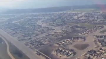Aerial view of devastated Fort McMurray. Not a house standing for blocks around (Credit: Global News)