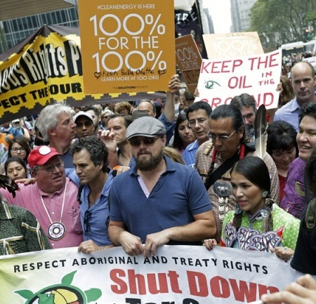 "Hollywood A-List actors Leonardo DiCaprio (front in blue) and Mark Ruffalo (in blue to his right) participate in the Sept 23, 2014 ""People's Climate March"" in New York."