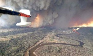 The fire out of control (Credit: Canadian Press)