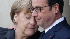 French President Francois Hollande hugs German Chancellor Angela Merkel as she arrives at the Elysee Palace before the giant Unity rally in Paris after the 2nd major attack (Credit: CNN)