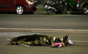 The body of a little girl lies covered in the street in Nice, just one of 84 victims of this senseless barbarianism
