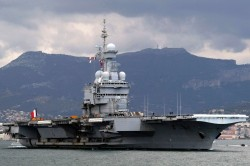 FILE - In this March 20, 2011 file photo, France's nuclear-powered aircraft carrier Charles de Gaulle leaves its home port of Toulon, southern France. France has decided to deploy an aircraft carrier in the Persian Gulf to help fighting Islamic State group in Iraq and Syria. The French president Francois Hollande announced Thursday Nov.5, 2015 his decision at the inauguration of the country's new ultra-secured defense ministry in Paris. (AP Photo/Claude Paris, File)