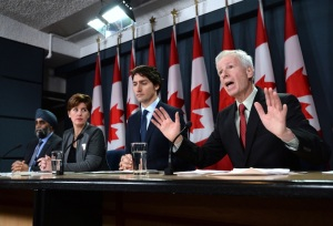 Minister of Foreign Affairs Stephane Dion delivers a statement as he is joined by Prime Minister Justin Trudeau, right to left, Minister of International Development and La Francophonie Marie-Claude Bibeau and Minister of National Defence Harjit Sajjan during a press conference at the National Press Theatre in Ottawa on Feb. 8, 2016. (Credit: The Canadian Press/Sean Kilpatrick)